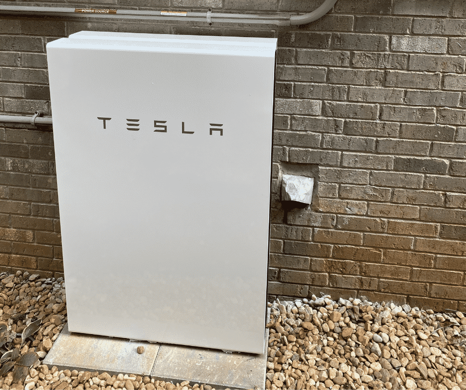 Two Powerwalls Stacked outside of Brick Wall